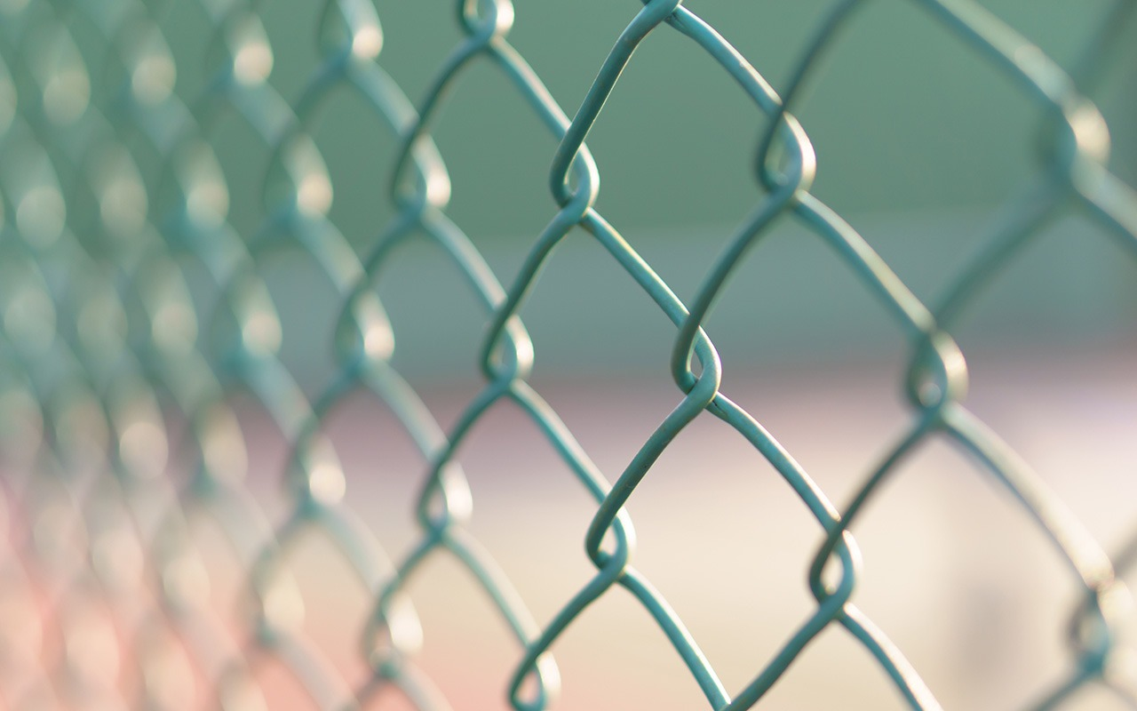 Green wire mesh steel at tennis court